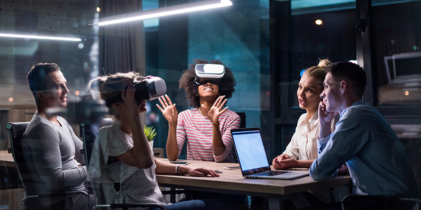 group of people looking through virtual reality goggles