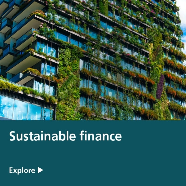 sustainable finance - housing flats with green shrubs