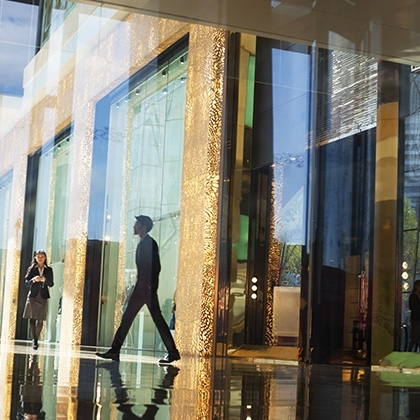 business people walking through the lobby of an office