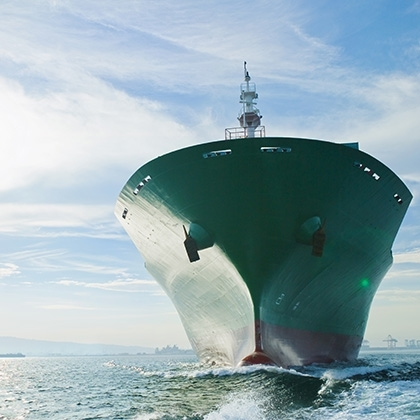 bow view of cargo ship sailing on ocean