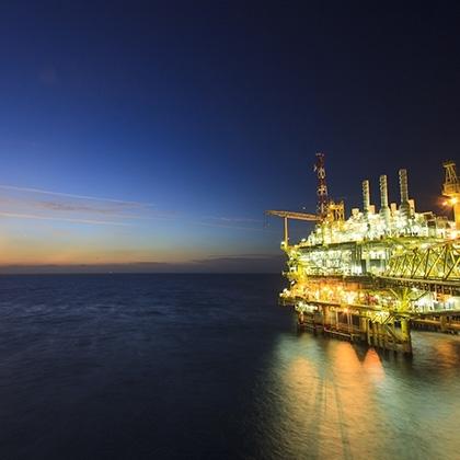 beautifully illuminated gas or rig platform at sunset time