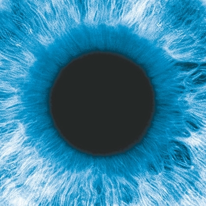 negative image of an eye with blue iris