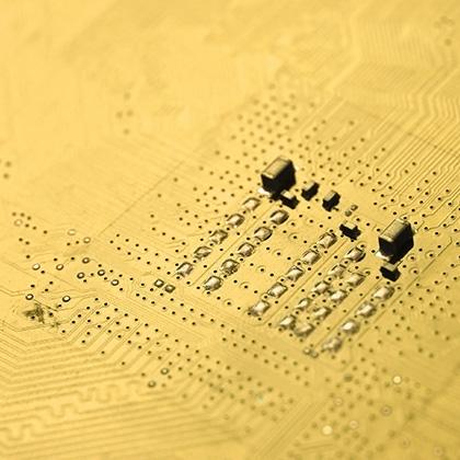 closeup of an golden electronic circuit board
