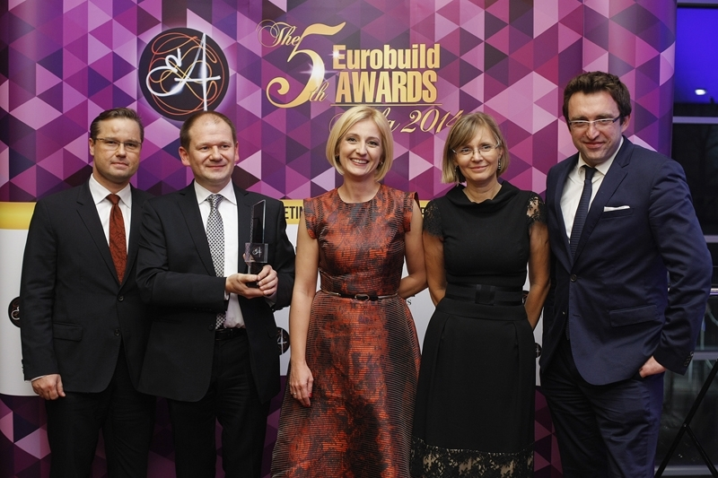 Poland RE team receiving law firm of the year award