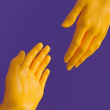 Two hands joining in a handshake