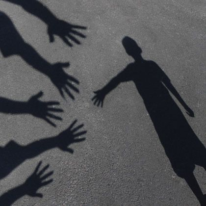 shadows of hands reaching out