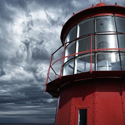 Lighthouse against a stormy sky