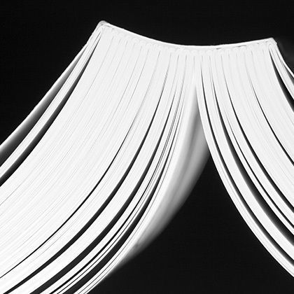 open white book pages forming a roof with black background