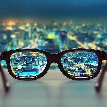 night cityscape focused in glasses
