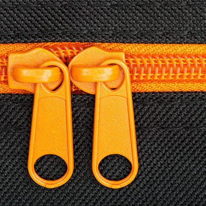 orange closure zip on a black background
