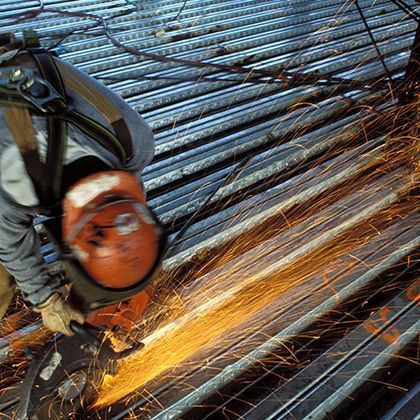 industrial worker welding on construction site