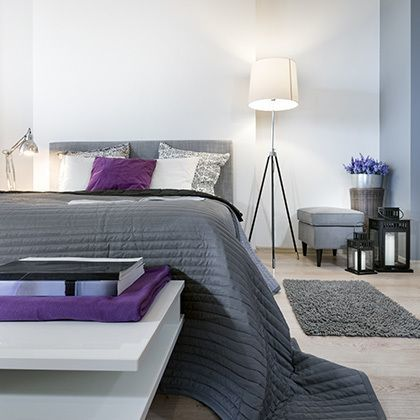 modern hotel bedroom interior design in white, grey and purple
