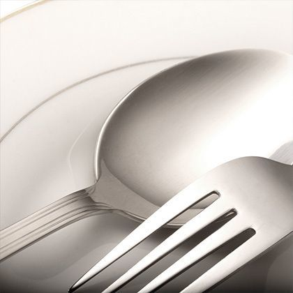 closeup of silver spoon and fork on a plate
