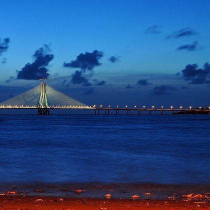bandra-worli sea link on partly cloudy evening