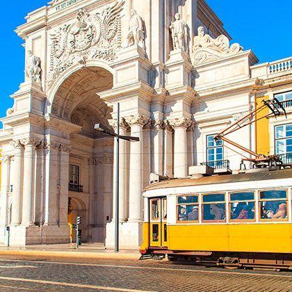yellow tram on praca de comercio square in lisbon, portugal