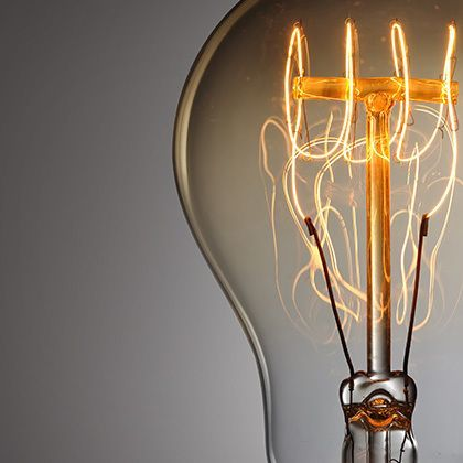 vintage light bulb showing the illuminated wires