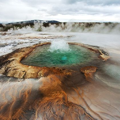 hveravellir geysir with bubbling hot water