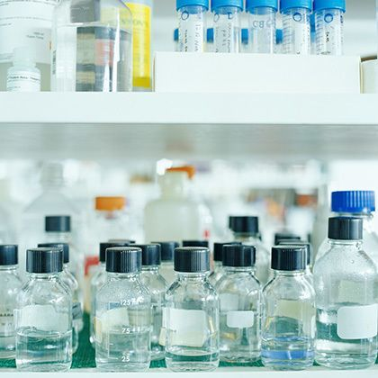 laboratory shelfs with bottles and vials