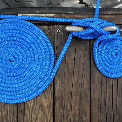 curled blue rope fastening boat