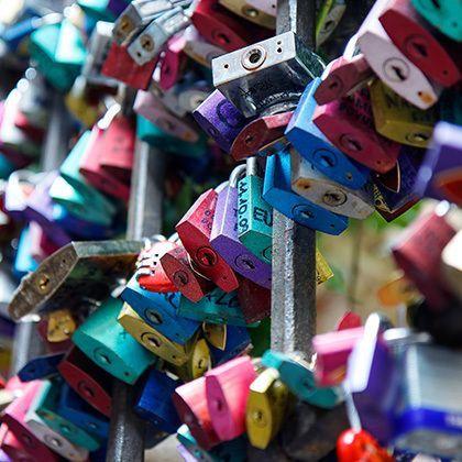 padlocks hanging on gate in juliet's courtyard in verona