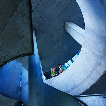 modern staircase on university campus with students chatting