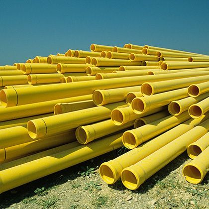 yellow stacked pvc piping for house construction