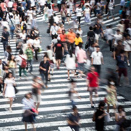 crowd crossing crosswalk in tokyo