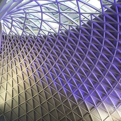view at purple lighted kings cross station ceiling in london