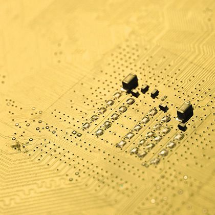 closeup of an golden electronic circuit board