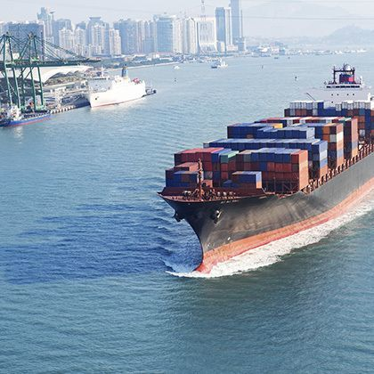 aerial view over a big container ship in the pacific ocean