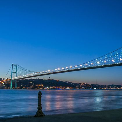 bosporus bridge at night in istanbul, turkey