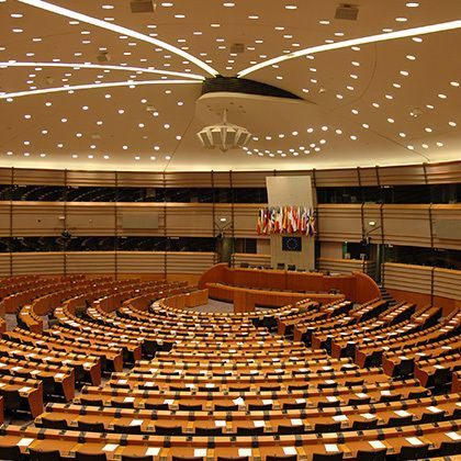 european parliament illuminated by dozens of small lights