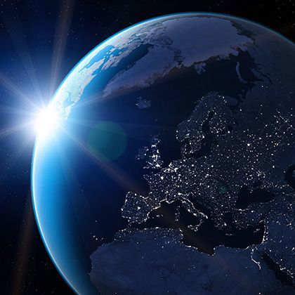 view from space showing globe with europe at night