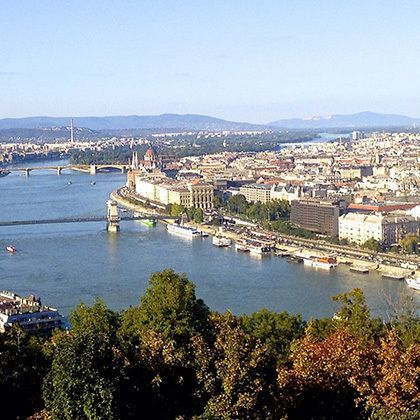 bird's eye angle view down to danube river over and the parliament building in budapest, hungary