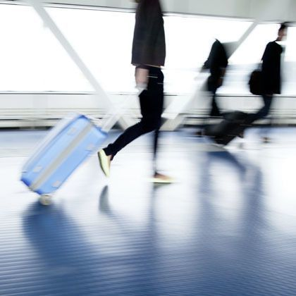 Person pulling a suitcase