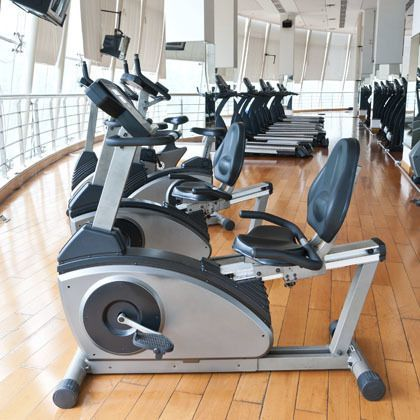 Row of exercise bikes in a gymnasium