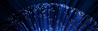 close up on the ends of many illuminated fiber optic strands