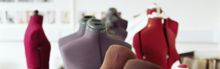 red, purple and brown tailor dummies